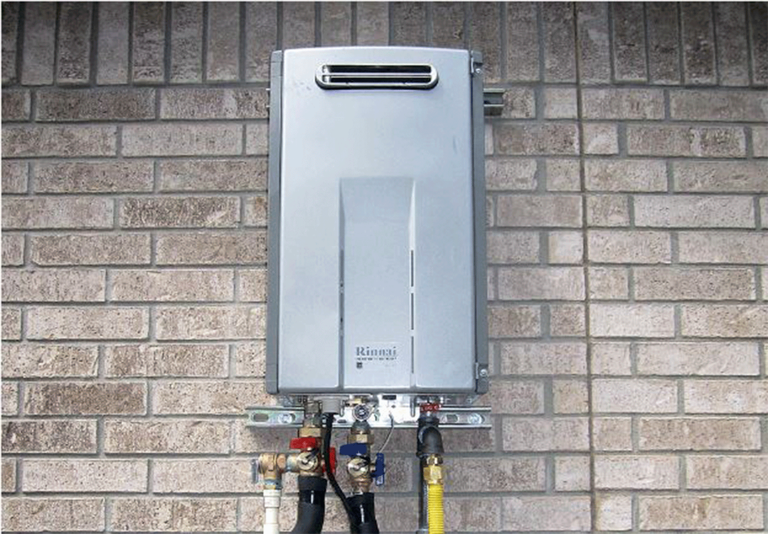Water heater on brick wall