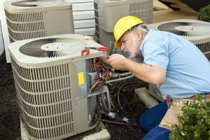 technician performing ac repair in davidson nc